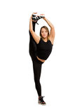 Young woman doing standing split isolated Stock Image