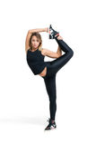 Young woman doing standing split isolated Royalty Free Stock Image