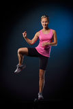 Young woman doing step exercises Royalty Free Stock Photo