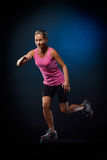Young woman doing step exercises Royalty Free Stock Image