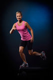 Young woman doing step exercises indoor Stock Photos