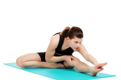 Young woman doing stretching exercise stock photography