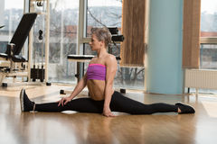 Young Woman Doing Stretching Exercise Royalty Free Stock Photography