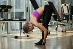 Young Woman Doing Stretching Exercise Royalty Free Stock Image
