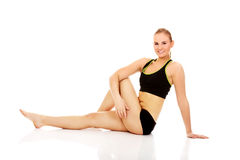 Young woman doing stretching exercise on the floor Stock Image