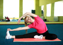 Young woman doing stretching exercise Royalty Free Stock Photos