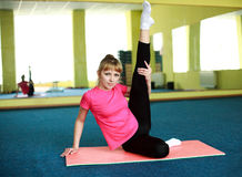 Young woman doing stretching exercise Stock Photos