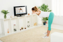 Young Woman Doing Stretching Exercises Royalty Free Stock Photography