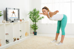 Young Woman Doing Stretching Exercises Stock Images