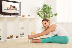 Young Woman Doing Stretching Exercises Stock Photography