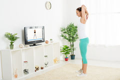 Young Woman Doing Stretching Exercises Royalty Free Stock Photo