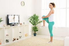 Young Woman Doing Stretching Exercises Royalty Free Stock Image