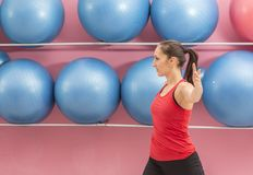 Woman in the Gym. Young woman doing stretching exercises in a gym Royalty Free Stock Photos