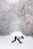 Young woman doing stretching exercises during winter Royalty Free Stock Photography