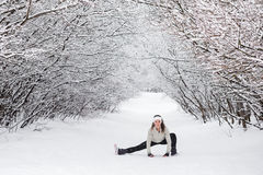 Young woman doing stretching exercises during winter Royalty Free Stock Photo