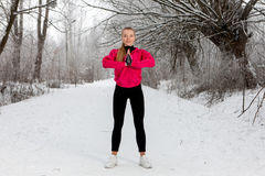 Young woman doing stretching exercises in winter Stock Image