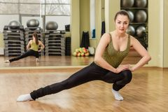 Young woman doing stretching in fitness class Royalty Free Stock Photography
