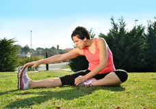 Young woman doing stretching Stock Photos