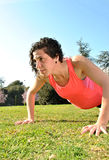 Young woman doing stretching Royalty Free Stock Photography