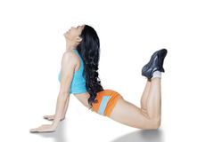 Young woman doing stretching in studio royalty free stock image