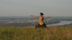 Young woman doing summer yoga on a hill above Novi Sad city, Fruska gora, Serbia. Woman doing summer yoga on a hill above Novi Sad city, Fruska gora, Serbia stock video