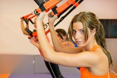 Free Young Woman Doing Suspension Training Stock Photography - 34258582