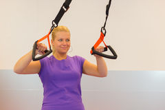 Young woman doing suspension training Royalty Free Stock Images