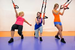 Young woman doing suspension training Royalty Free Stock Photos