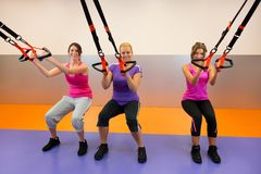 Young woman doing suspension training Royalty Free Stock Image