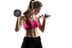 Young woman doing swing exercise with a dumbbells as a part of a fitness workout Stock Image