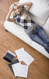 Young Woman Doing Taxes Royalty Free Stock Photos