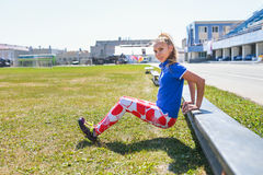 Young woman doing tricep dips on a bench outdoor, fitness and sport lifestyle royalty free stock image