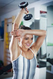Young woman doing Triceps exercise Stock Photos