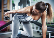 Young woman doing triceps exercise Stock Images