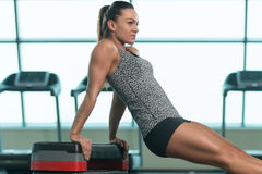 Young Woman Doing Triceps Exercise On Stepper Stock Image