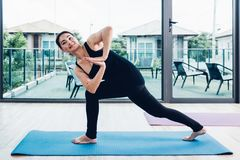 Young woman doing twist pose yoga royalty free stock image
