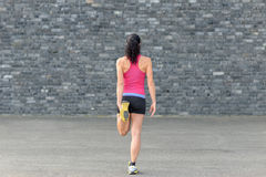 Young woman doing warming up exercises Royalty Free Stock Images