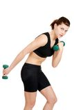 Young woman doing a workout Royalty Free Stock Images