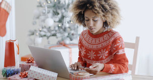 Young woman doing Xmas shopping online Stock Photo