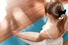 Young woman doing yoga Stock Image