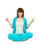 Young woman doing yoga Royalty Free Stock Photos
