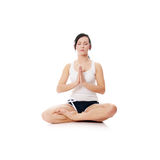 Young woman doing yoga Stock Photography