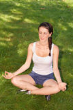 Young woman doing yoga Royalty Free Stock Photography