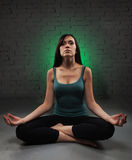 Young woman doing yoga Royalty Free Stock Image