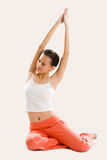 Young woman doing yoga. Young woman doing stretching exercise on the floor Royalty Free Stock Image