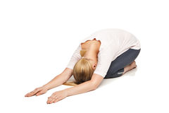 Young woman doing yoga against white background Royalty Free Stock Photo