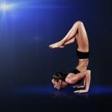 Young woman doing yoga asana Royalty Free Stock Photo