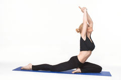 Young woman doing yoga asana Royalty Free Stock Photography