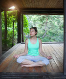 Young woman doing yoga asana in the evening Royalty Free Stock Photo
