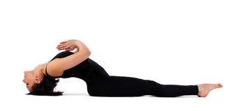 Young woman doing yoga asana - fish pose isolated Royalty Free Stock Images